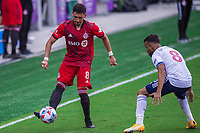 ORLANDO, FL - APRIL 24: Marky Delgado #8 of Toronto FC kicks the ball during a game between Vancouver Whitecaps and Toronto FC at Exploria Stadium on April 24, 2021 in Orlando, Florida.