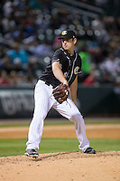 Charlotte Knights relief pitcher Eric Surkamp (23) in action against the Toledo Mud Hens at BB&T BallPark on April 27, 2015 in Charlotte, North Carolina.  The Knights defeated the Mud Hens 7-6 in 10 innings.   (Brian Westerholt/Four Seam Images)