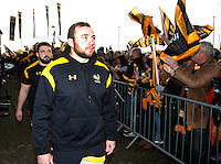 Photo: Richard Lane/Richard Lane Photography. Wasps v Leicester Tigers. Aviva Premiership. 08/01/2017. Wasps' captain Matt Mullan leads the team in as supporters cheer on.