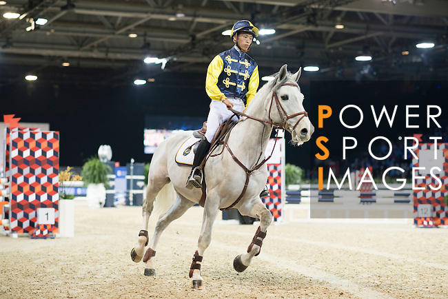 Team Hong Kong: Rider Jacqueline Lai of Hong Kong and Jockey Vincent Ho of China compete during the Hong Kong Jockey Club Race of the Riders, part of the Longines Masters of Hong Kong on 10 February 2017 at the Asia World Expo in Hong Kong, China. Photo by Victor Fraile / Power Sport Images
