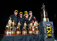 Nov 11, 2018; Pomona, CA, USA; NHRA top fuel driver Steve Torrence poses for a portrait with father Billy Torrence and mother Kay Torrence as he celebrates after winning the Auto Club Finals at Auto Club Raceway. Torrence swept all six of the countdown to the championship races to clinch the world championship. Mandatory Credit: Mark J. Rebilas-USA TODAY Sports