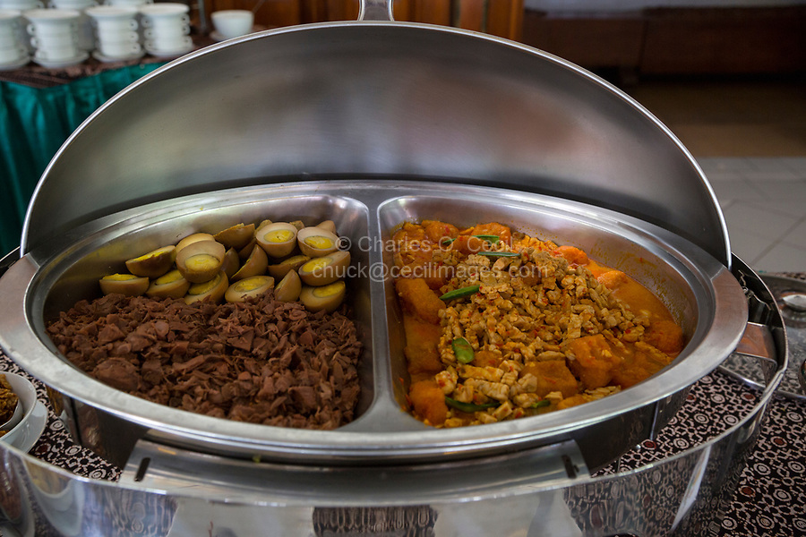 Yogyakarta, Java, Indonesia.  Gudeg (jackfruit) and boiled eggs on left; Krechek (Krecek)(Spicy Cow Skin Stew) on right.  Both are Yogyakarta Specialities.
