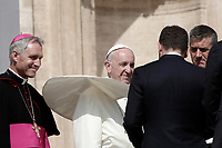 Un soffio di vento solleva la mantellina di Papa Francesco  al termine dell'udienza generale del mercoledi' in Piazza San Pietro, Citta' del Vaticano, 30 agosto, 2017.<br /> A gust of wind blows Pope Francis' mantle at the end of his weekly general audience in St. Peter's Square at the Vatican on August 30, 2017.<br /> UPDATE IMAGES PRESS/Isabella Bonotto<br /> <br /> STRICTLY ONLY FOR EDITORIAL USE