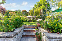 BNPS.co.uk (01202 558833)<br /> Pic: Strutt&Parker/BNPS<br /> <br /> Pictured: The property has a double plot of garden - an elevated rear garden and then a second plot that overlooks fields to the rear. <br /> <br /> An 18th century cottage in 'the prettiest village in England' is on the market for £675,000.<br /> <br /> Number 2 School Lane is Grade II listed, built with beautiful Cotswold stone and filled with character features like exposed timber beams and original fireplaces.<br /> <br /> The attractive three-bedroom property is in the highly sought after Wiltshire village of Castle Combe.<br /> <br /> The quintessentially English village has been used regularly as a film location and the houses are mostly made with honey-coloured Cotswold stone.