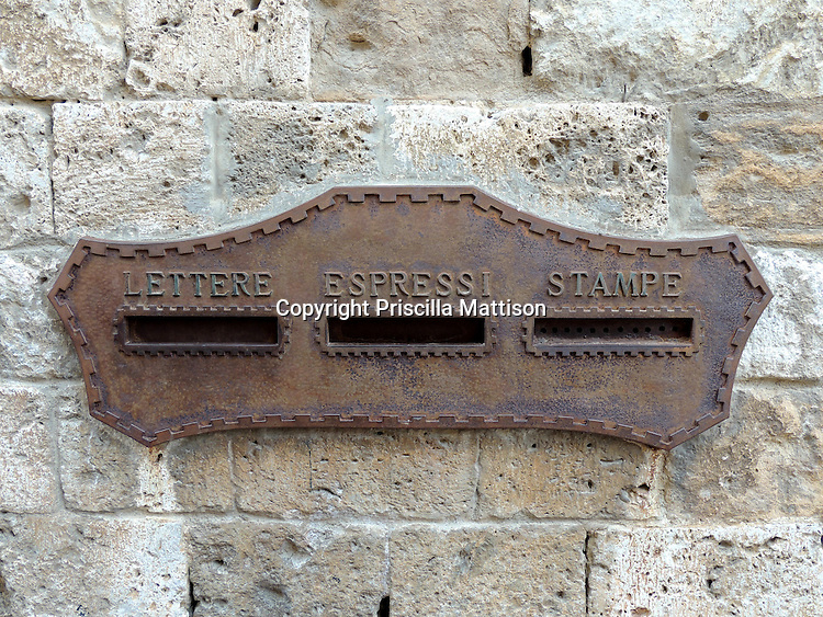 San Gimignano, Italy - October 4, 2012:  A letter box is embedded in a stone wall.