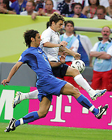 Bobby Convey (15) of the USA leaps past Cristian Zaccardo (2) of Italy. The USA and Italy played to a 1-1 tie in their FIFA World Cup Group E match at Fritz-Walter-Stadion, Kaiserslautern, Germany, June 17, 2006.