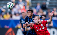 CARSON, CA - FEBRUARY 15: Jacob Shaffelburg #24 of Toronto FC battles with Julian Araujo #22 of the Los Angeles Galaxy during a game between Toronto FC and Los Angeles Galaxy at Dignity Health Sports Park on February 15, 2020 in Carson, California.