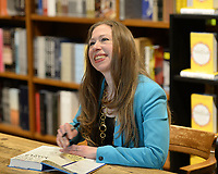 CORAL GABLES, FL - OCTOBER 22: Chelsea Clinton signs copies of her new book 'It's Your World: Get Informed, Get Inspired & Get Going!' at Books and Books on October 22, 2015 in Coral Gables, Florida<br /> <br /> People:  Chelsea Clinton