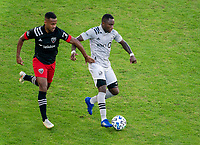 WASHINGTON, DC - NOVEMBER 8: Ola Kamara #9 of D.C. United defends Zachary Brault-Guillard #15 of the Montreal Impact during a game between Montreal Impact and D.C. United at Audi Field on November 8, 2020 in Washington, DC.