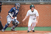 TJ Nichting (1) of the Charlotte 49ers follows through on his swing against the Akron Zips at Hayes Stadium on February 22, 2015 in Charlotte, North Carolina.  The Zips defeated the 49ers 5-4.  (Brian Westerholt/Four Seam Images)