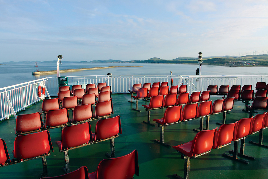 Red seats on the Caledonian MacBrayne Ardrossan to Brodick Arran Ferry leaving Ardrossan, Ayrshire<br /> <br /> Copyright www.scottishhorizons.co.uk/Keith Fergus 2011 All Rights Reserved
