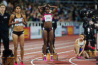 22 AUG 2013 - STOCKHOLM, SWE - Marilyn Okoro (centre) of Great Britain warm's up before the women's 800m race during the DN Galen meet of the 2013 Diamond League in the Stockholm Olympic Stadium in Stockholm, Sweden (PHOTO COPYRIGHT © 2013 NIGEL FARROW, ALL RIGHTS RESERVED)