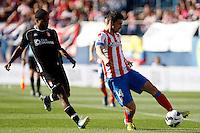 Atletico's Gabi and Granada's Ighalo during La Liga BBVA match. April 14, 2013.(ALTERPHOTOS/Alconada)
