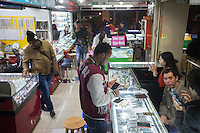 African and Chinese people are seen in an electronics mall an area of Guangzhou known to locals as 'Chocolate City', Guangzhou, Guangdong Province, China, 08 December 2014. The health authorities of Guangzhou are said to be stepping up their monitoring of the African community in light of the ongoing outbreak of the Ebola virus disease in West Africa.