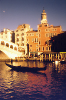 Italy,Venice, The Grand Canal with gondolier and the Rialto Bridge