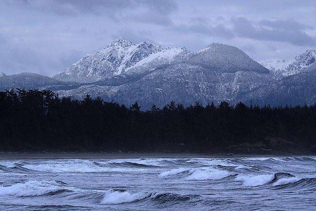 HIGH SEAS AND SNOW-CAPPED MOUNTAINS MAKE UP THE LANDSCAPE NEAR TOFINO, BRITISH COLUMBIA,CANADA