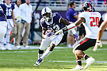 TCU Horned Frogs running back Sewo Olonilua (33) in action during the game between the Texas Tech Red Raiders and the TCU Horned Frogs at the Amon G. Carter Stadium in Fort Worth, Texas.