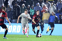 CARY, NC - DECEMBER 13: Ryan Ludwick #12 of Stanford University is chased by Riley Strassner #13 of Georgetown University during a game between Stanford and Georgetown at Sahlen's Stadium at WakeMed Soccer Park on December 13, 2019 in Cary, North Carolina.