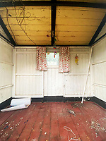BNPS.co.uk (01202) 558833. <br /> Pic: Charterhouse/BNPS<br /> <br /> A dilapidated late Victorian shepherd's hut has sold for £16,000 following a bidding war between a wealthy Londoner and a local herder.<br /> <br /> The 8ft high, 9ft wide, 6ft deep wooden hut is covered in rot and has a leaky roof.<br /> <br /> But despite being in desperate need of restoration, it sold for 20 times its £800 estimate with Charterhouse, of Sherborne, Dorset.<br /> <br /> The London-based buyer who secured the hut is thought to want to turn it into a holiday home or outside office.