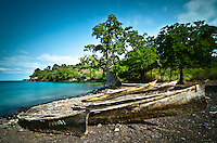 wooden carved dugout, on the beach of the lagoa azul one of the most beautiful bays in sao tomé island