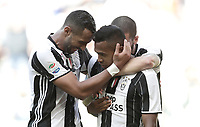 Calcio, Serie A: Juventus vs Crotone. Torino, Juventus Stadium, 21 maggio 2017.<br /> Juventus' Alex Sandro, center, celebrates with teammates after scoring during the Italian Serie A football match between Juventus and Crotone at Turin's Juventus Stadium, 21 May 2017. Juventus defeated Crotone 3-0 to win the sixth consecutive Scudetto.<br /> UPDATE IMAGES PRESS/Isabella Bonotto