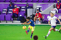 ORLANDO, FL - JANUARY 18: Gisela Robledo #10 of Colombia kicks the ball during a game between Colombia and USWNT at Exploria Stadium on January 18, 2021 in Orlando, Florida.