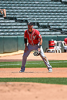 Will Middlebrooks (16) of the El Paso Chihuahuas on defense against the Salt Lake Bees in Pacific Coast League action at Smith's Ballpark on July 26, 2015 in Salt Lake City, Utah. El Paso defeated Salt Lake 6-3 in 10 innings. (Stephen Smith/Four Seam Images)