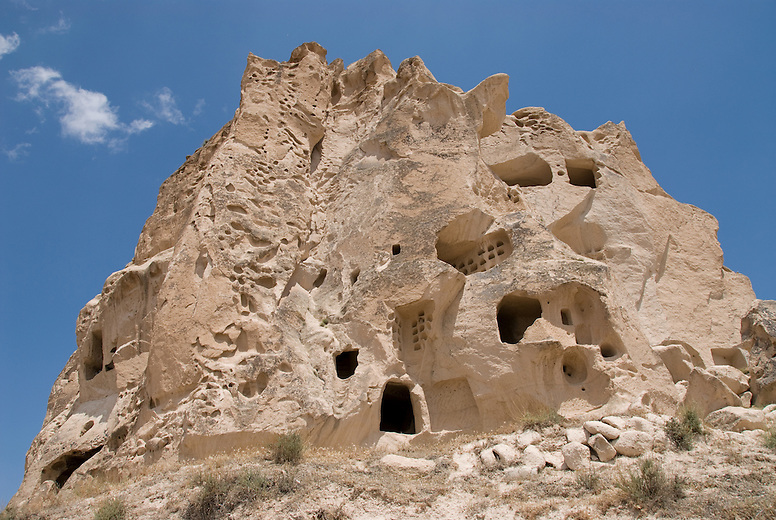 One of the thousands of cave dwellings in Cappadocia. With the outer layers of rock now washed away by erosion, one can see the honeycombed structure of tunnels and rooms that likely held many families. The easily carvable rock, called tufa, was home to over 3000 cave houses, churches and monasteries.