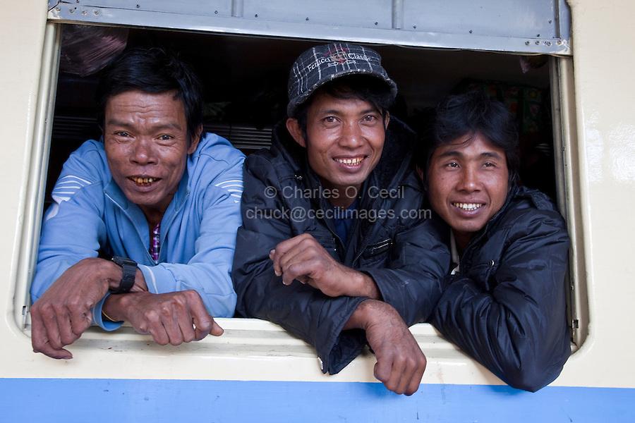 Myanmar, Burma.  Burmese Passengers on their Train at the Kalaw Train Station.