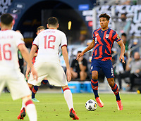 AUSTIN, TX - JULY 29: Nicholas Gioacchini #8 of the United States looks to pass the ball during a game between Qatar and USMNT at Q2 Stadium on July 29, 2021 in Austin, Texas.