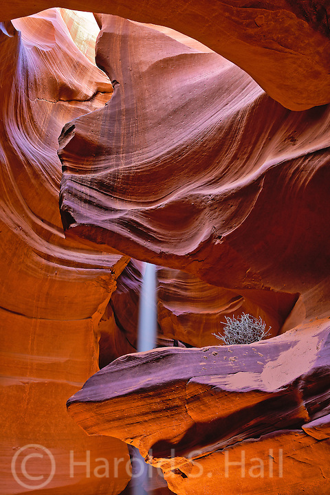 Antelope Canyon near Page Arizona is a slot canyon.  Near the top, where the sun is brightest, the colors are bright yellow.  Closer to the bottom of the canyon the colors are orange and blue in the darkest areas.