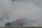 Monster Energy NASCAR Cup Series<br /> Tales of the Turtles 400<br /> Chicagoland Speedway, Joliet, IL USA<br /> Sunday 17 September 2017<br /> Martin Truex Jr, Furniture Row Racing, Furniture Row/Denver Mattress Toyota Camry celebrates with a burnout after winning<br /> World Copyright: Logan Whitton<br /> LAT Images