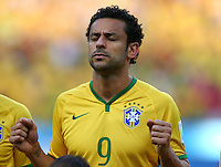 Fred of Brazil prays before kick off