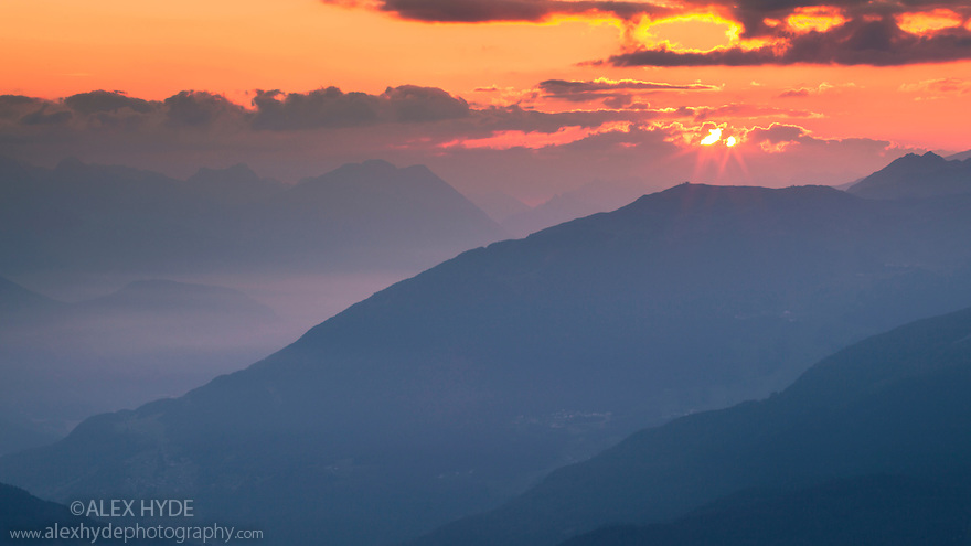 Sun rising over mountain landscape at dawn, Nordtirol, Tirol, Austrian Alps, Austria, July.