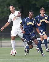 Quinnipiac University midfielder Willya Mekolo (9) brings the ball forward. Boston College defeated Quinnipiac, 5-0, at Newton Soccer Field, September 1, 2011.