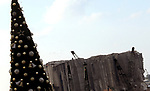 A Christmas tree with names of those who died during Beirut port explosion, is seen near the damaged grain silo, in Beirut, Lebanon December 22, 2020. Photo by Haitham Moussawi
