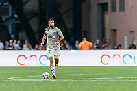 FOXBOROUGH, MA - JULY 25: Rudy Camacho #4 of CF Montreal brings the ball forward during a game between CF Montreal and New England Revolution at Gillette Stadium on July 25, 2021 in Foxborough, Massachusetts.