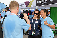 Houston, TX - Thursday July 20, 2017: Carli Lloyd of the Houston Dash poses for photos with fans during a match between Manchester United and Manchester City in the 2017 International Champions Cup at NRG Stadium.