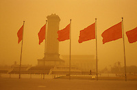 Tiananmen square.A dust storm strikes Beijing, China, turning the sky an amber colour and reducing visibility to 500 meters. Extensive deforestation and desertification in northern China have fueled the dust stoms. Nearly one million tons of Gobi Desert sand blows into Beijing each year..20-MAR-02