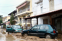 Cars on a pile of mud and debris in Agia Triada