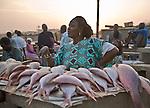A woman sells fish at this beachside fish market in Dakar, Senegal.