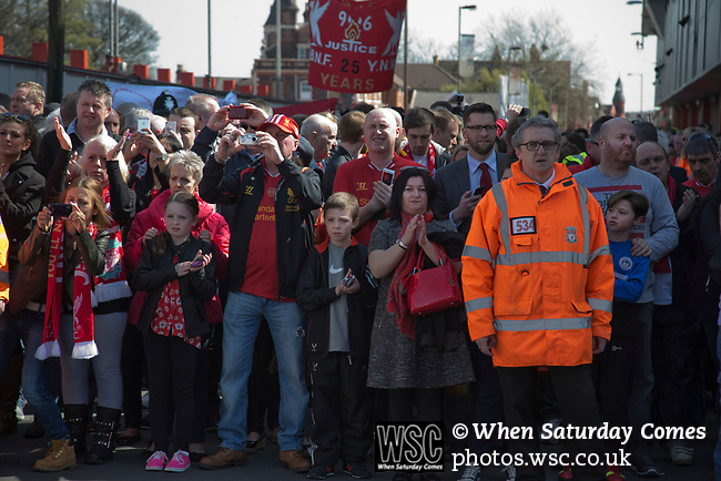 Fans awaiting the arrival of the current team before the 25th anniversary memorial service to the 1989 Hillsborough disaster at Liverpool Football Club's Anfield Stadium. The Hillsborough stadium disaster led to 96 Liverpool football fans losing their lives in a crush at an FA Cup semi final tie against Nottingham Forest. The families of the victims campaigned against the original verdict of the incident and were rewarded with a new inquiry held in 2014 into events at the match at Hillsborough. Photo by Colin McPherson.