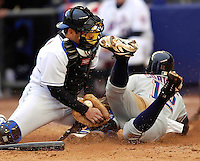 3 April 2006: Paul Lo Duca, catcher for the New York Mets, manages to hold on to the ball and get Alfonso Soriano out at the plate during Opening Day play against the Washington Nationals at Shea Stadium, in Flushing, New York. The Mets defeated the Nationals 3-2 to lead off the 2006 MLB season...Mandatory Photo Credit: Ed Wolfstein Photo..
