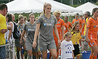 Philadelphia defender, Allison Falk (3), enters the stadium with her young escort.  The Philadelphia Independence scored three first half goals, and went on to win 4-1 over Sky Blue at John A Farrell Stadium in West Chester, Pennsylvania.