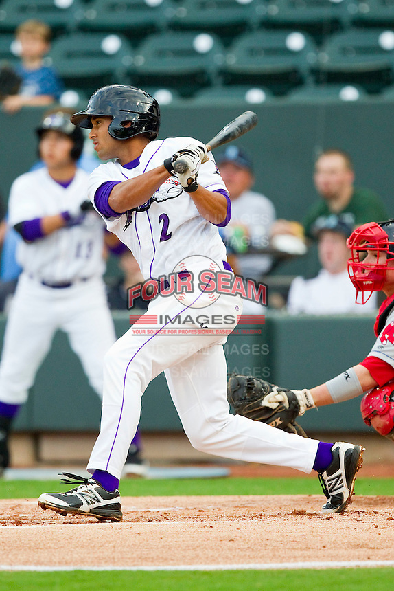 Marcus Semien #2 of the Winston-Salem Dash follows through on his swing against the Salem Red Sox at BB&T Ballpark on May 5, 2012 in Winston-Salem, North Carolina.  The Red Sox defeated the Dash 6-4.  (Brian Westerholt/Four Seam Images)