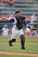 Catcher Logan Johnson #18 of the Winston-Salem Dash makes a throw to first base at Wake Forest Baseball Park June 14, 2009 in Winston-Salem, North Carolina. (Photo by Brian Westerholt / Four Seam Images)