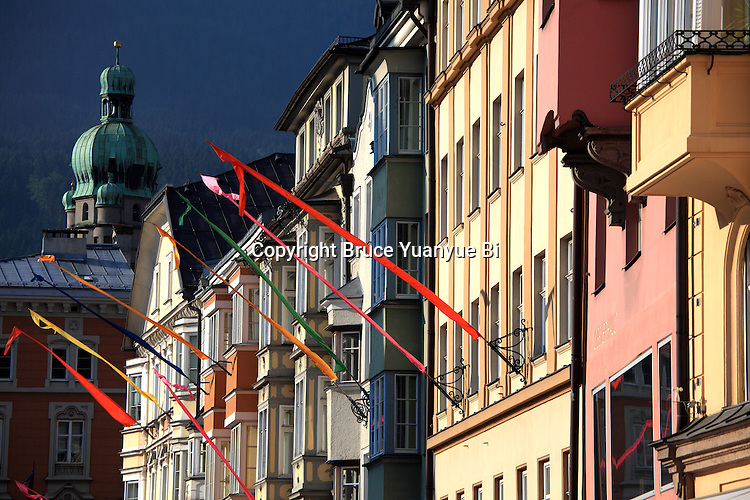 Colourful building facades on Maria Theresien Street with the City Tower in the background. Innsbruck. Austria