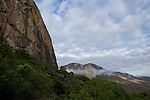 Climb of Cameleon summit, view on Tsaranoro valley, cliffs of mount Tsaranoro covered by yellow lichens..Montee au sommet du Cameleon Vue sur vallee du Tsaranoro, murailles  du mont Tsaranoro (1910 m) colorees par les lichens jaunes