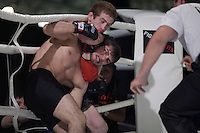 Moscow, Russia, 05/06/2010..Murad Machaev grabs Zubaira Tukhugov in a neck-hold and punches him in the face during a bout of mix-fighting in the new Fight Nights boxing tournament.