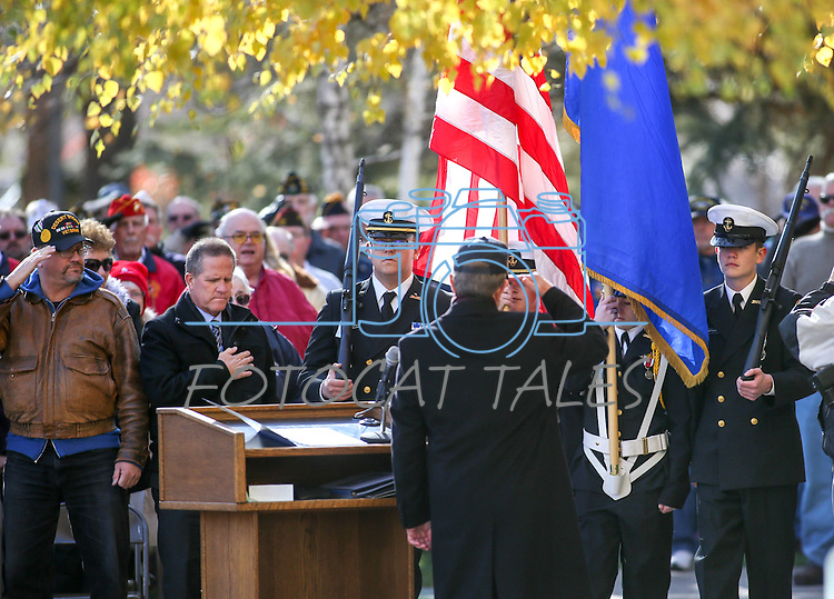 Carson City Mayor Bob Crowell salutes the flag during the Pearl Harbor 75th Commemoration at the U.S.S. Nevada memorial at the Capitol in Carson City, Nev. on Wednesday, Dec. 7, 2016. <br /> Photo by Cathleen Allison/Nevada Photo Source